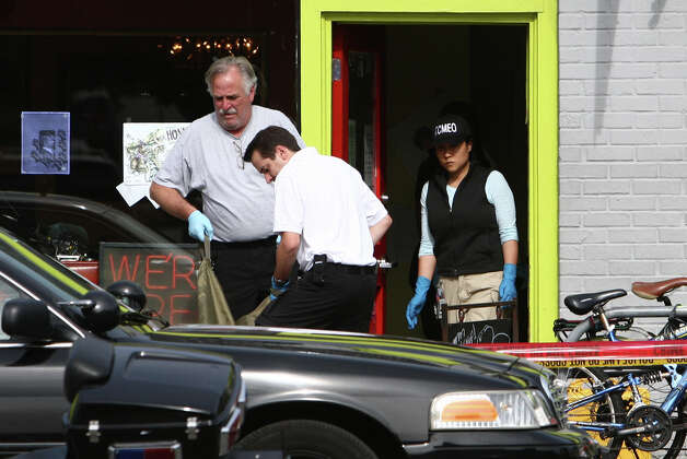 A body is removed after five people were shot at Cafe Racer on Roosevelt Way NE in Seattle. Four of the victims died from the violence. Another person was shot and 