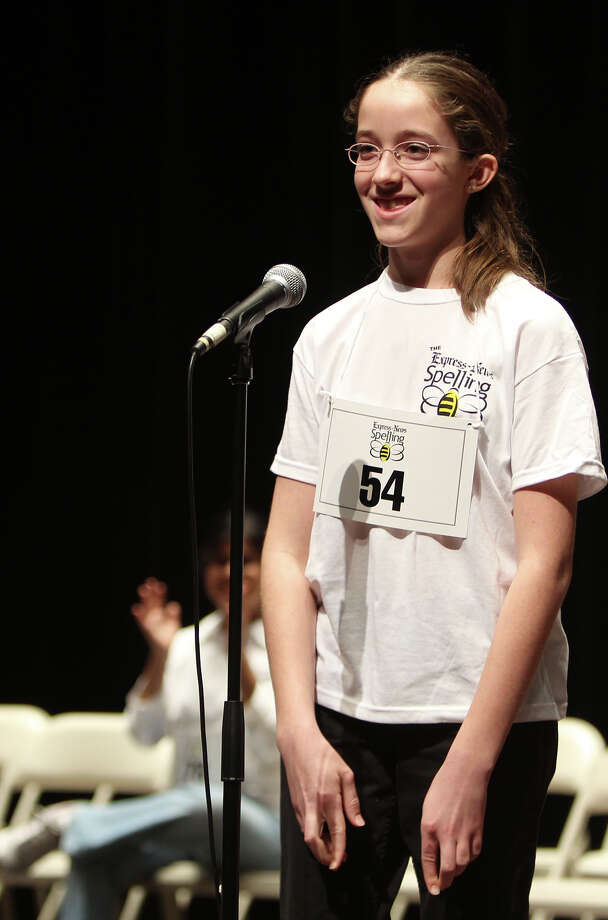 "First-place winner Sarah Hurlin of the Family Educators Alliance of South Texas smiles after spelling the final word ""leechcraft"" correctly at the 59th Annual Regional Spelling Bee, sponsored by the San Antonio Express-News at Laurie Auditorium, Saturday, March 10, 2012. Photo: JENNIFER WHITNEY, For The Express-News / special to the Express-News"
