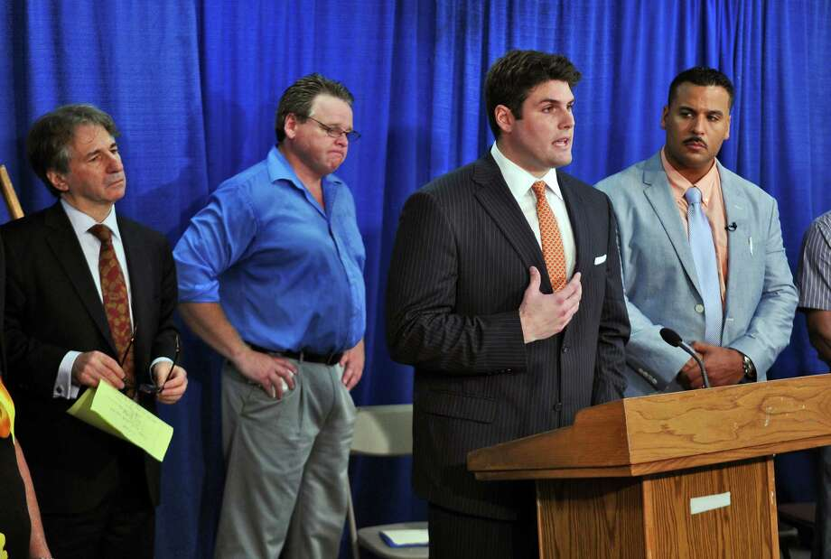 Reade Seligmann, second from right, and two Duke University lacrosse teammates were  wrongly accused in a sexual assault in 2006. He and Barry Scheck, Co-Director of the Innocence Project, left, and fellow exonerees want the state legislature to pass reforms to prevent wrongful convictions, during a press conferenece at the Legislative Office Building on Wednesday May 30, 2012 in Albany, NY. Standing with them are Steven Barnes, second from left, and Fernando Bermudez, right, both released from New York prisons after serving 19 and18 years, respectively, for crimes they did not commit. (Philip Kamrass / Times Union ) Photo: Philip Kamrass / 00017876A