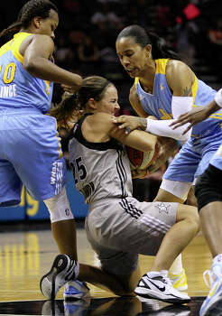 San Antonio Stars' Becky Hammon gets tied up for a jumpball with Chicago Sky's Eshaya Murphy, right, as Epiphanny Prince assists during the second half at the AT&T Center, Wednesday, May30, 2012. The Stars lost their season opener, 77-63. Photo: Jerry Lara, San Antonio Express-News / © San Antonio Express-News