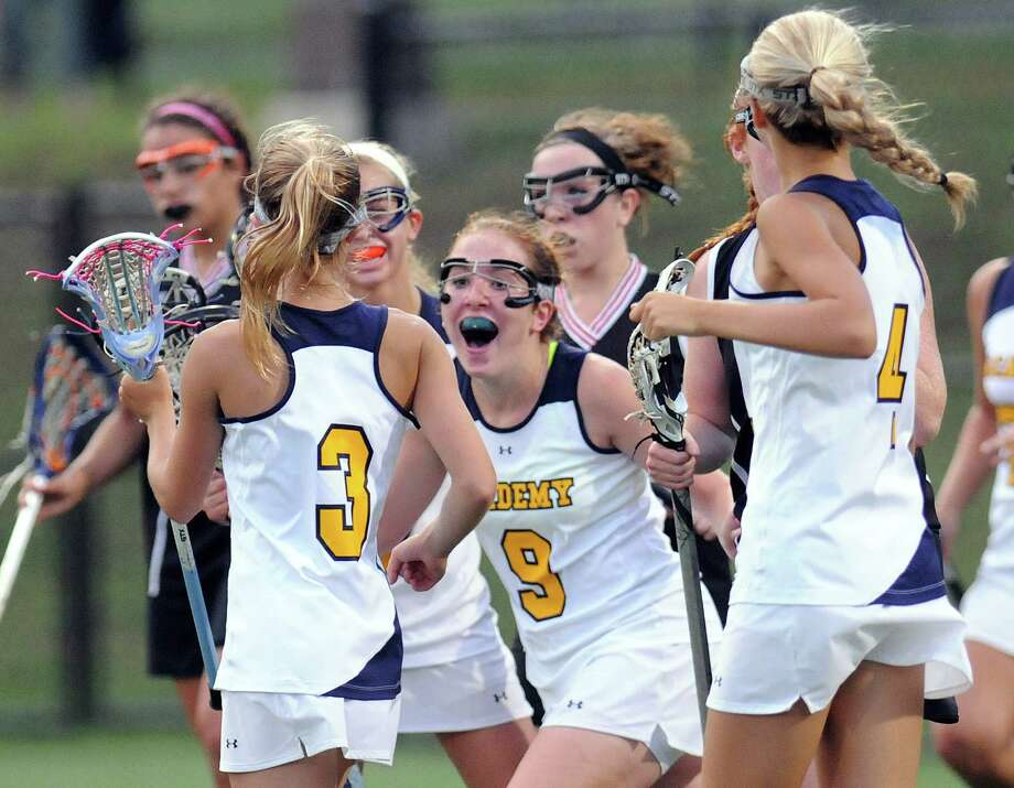 Albany Academy's Emily Downie (9) celebrates a point against Glens Falls' during their Section II Class C girls' lacrosse championship at the University at Albany in Albany, N.Y., Wednesday, May 30, 2012. (Hans Pennink / Special to the Times Union) High School Sports Photo: Hans Pennink / Hans Pennink