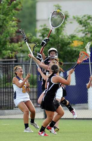 Glens Falls' goalie Jillian Rizzo ,center, moves the ball past Albany Academy defenders during their Section II Class C girls' lacrosse championship at the University at Albany in Albany, N.Y., Wednesday, May 30, 2012. (Hans Pennink / Special to the Times Union) High School Sports Photo: Hans Pennink / Hans Pennink