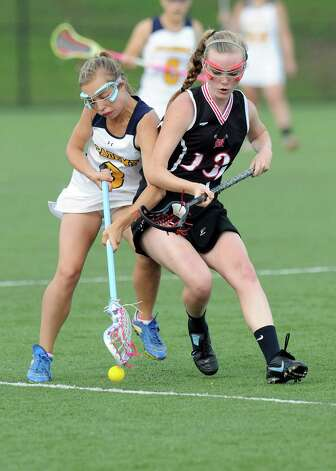 Albany Academy's Gabby Uccellini ,left, Glens Falls' Christine Hogan battle for the ball during their Section II Class C girls' lacrosse championship at the University at Albany in Albany, N.Y., Wednesday, May 30, 2012. (Hans Pennink / Special to the Times Union) High School Sports Photo: Hans Pennink / Hans Pennink