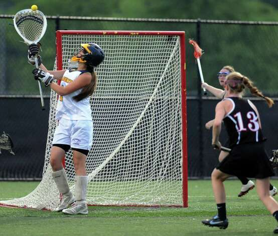 Albany Academy Goalie Alex Macaffer stops a Glens Falls' shot on goal during their Section II Class C girls' lacrosse championship at the University at Albany in Albany, N.Y., Wednesday, May 30, 2012. (Hans Pennink / Special to the Times Union) High School Sports Photo: Hans Pennink / Hans Pennink