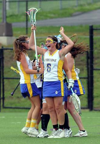 Queensbury celebrates a 12-8 win over Burnt Hills- Ballston Lake during their Section II Class B girls' lacrosse championship at the University at Albany in Albany, N.Y., Wednesday, May 30, 2012. (Hans Pennink / Special to the Times Union) High School Sports Photo: Hans Pennink / Hans Pennink