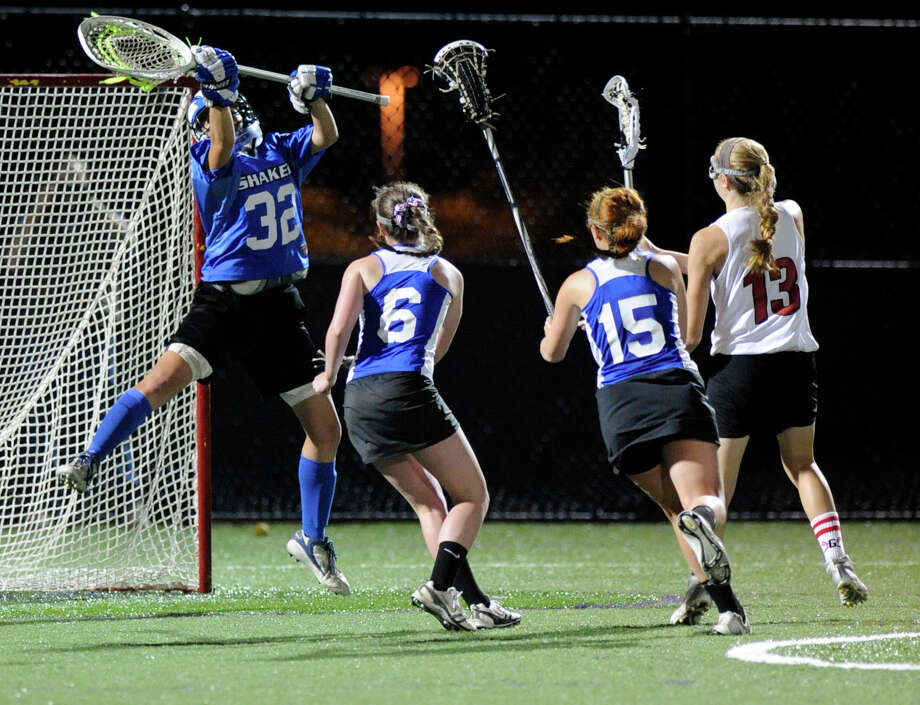 Shaker Goalie Anne Morrison (32) makes a save against Guilderland during their Section II Class A girls' lacrosse championship at the University at Albany in Albany, N.Y., Wednesday, May 30, 2012. (Hans Pennink / Special to the Times Union) High School Sports Photo: Hans Pennink / Hans Pennink