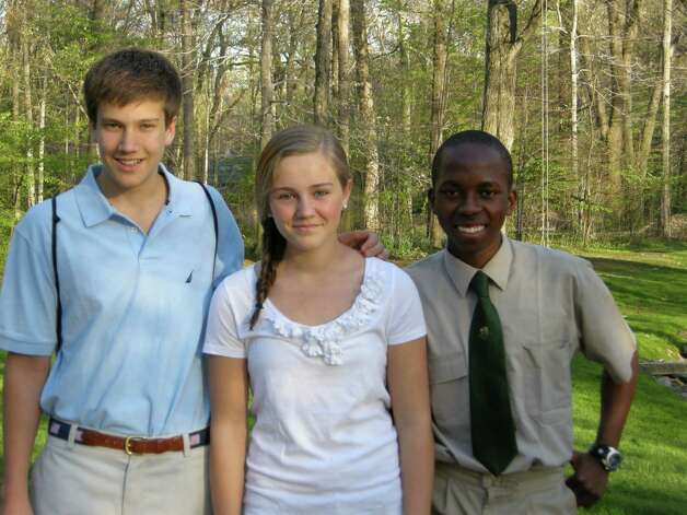 Alex Menu, far right, was one of six scholars from South Africa who visited families from St. Luke's School. Pictured with Menu are Craig and Paige Ballard, his host family. June 1, 2012, Darien, Conn. Photo: Contributed Photo