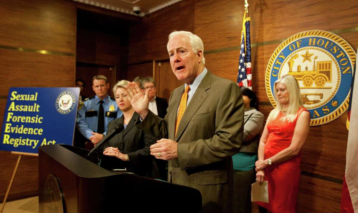 U. S. Sen. John Cornyn, center, says there is a untested rape kit backlog nationwide of nearly 400,000. Cornyn is pushing legislation to allow more funding.
