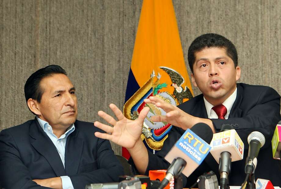 Lawyer Pablo Fajardo, right, who represents the Amazon Defense Coalition in a case against U.S. oil company Chevron for environmental damage alleged caused by Texaco in the Amazon rain forest before it left in the 1990s., speaks at a press conference in Quito, Thursday, Aug. 3, 2009.  An Ecuadorian judge presiding over the billionaire environmental lawsuit said Wednesday that he was set up in videotapes, released by Chevron, that show him allegedly telling businessmen he's already made up his mind to rule against the company.  At left is Luis Yanza, the president of the delegated of the Amazon Defense Coalition. (AP Photo/Dolores Ochoa) Photo: Dolores Ochoa, AP