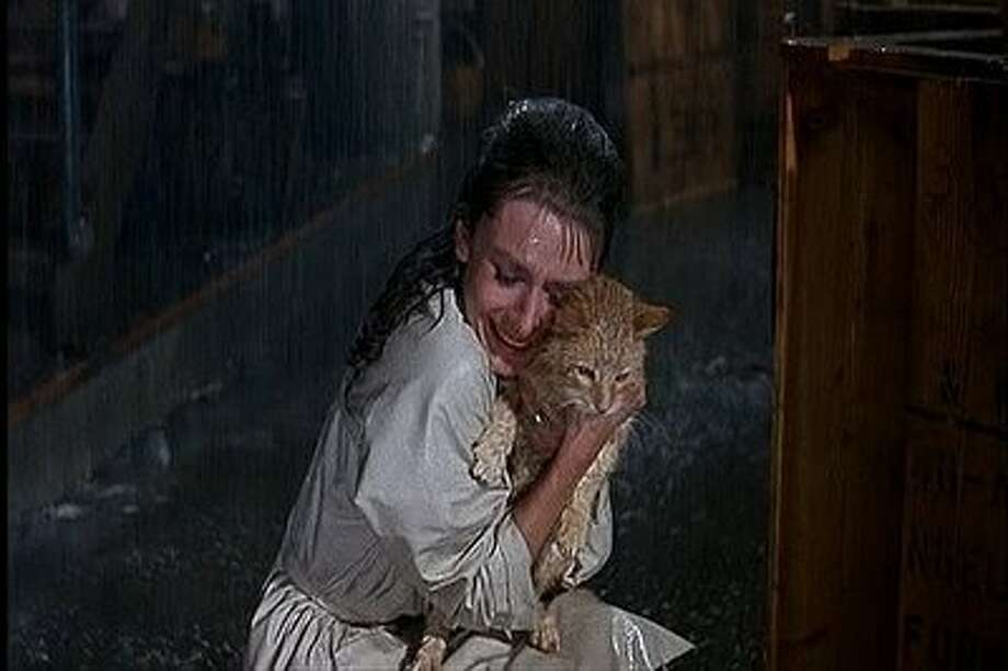 """At the end of """"Breakfast at Tiffany's,"""" Holly Golightly (Audrey Hepburn) finds her cat. Photo: Paramount 1961"""