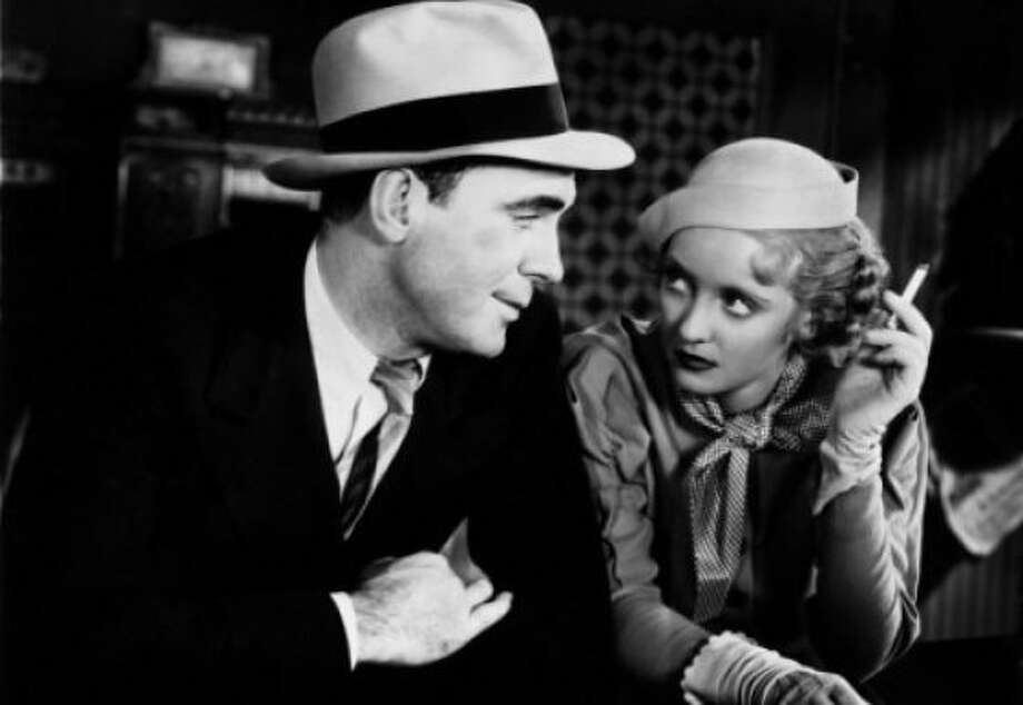 "Pat O'Brien and Bette Davis in ""Bureau of Missing Persons."" Photo: Warner Bros. 1933"