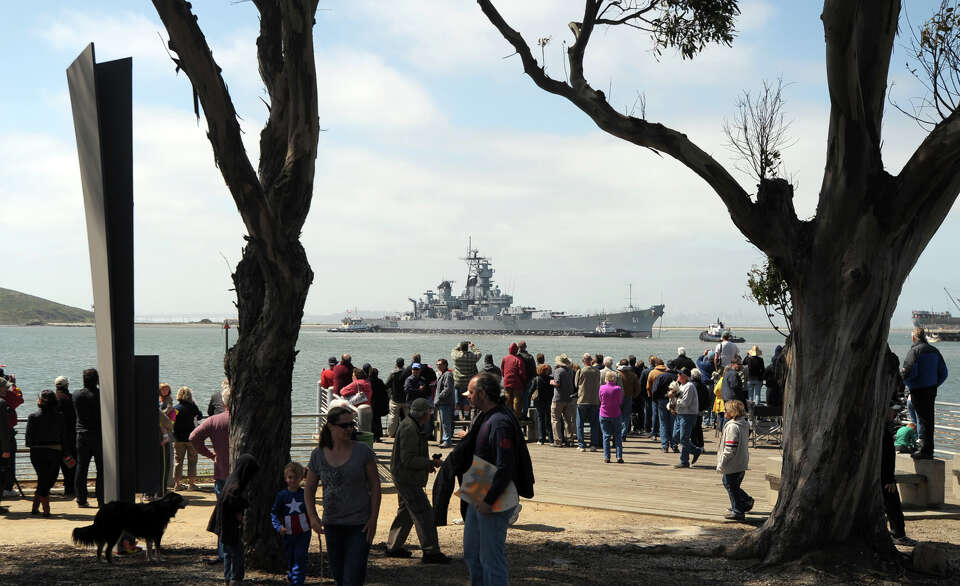A large crowd watches the USS Iowa leave from the Port of Richmond on Saturday, May 26, 2012, in Ric