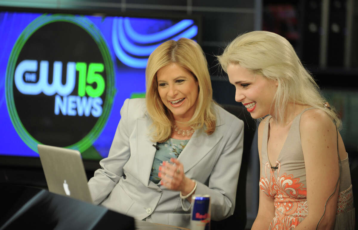 WRGB/CW anchor Dori Marlin, left, and Laura LaFrate of Scotia watches the final minutes of America's Next Top Model at the WRGB/CW studios Wednesday, May 30, 2012 in Niskayuna, N.Y. Laura wasn't the named the winner. (Lori Van Buren / Times Union)