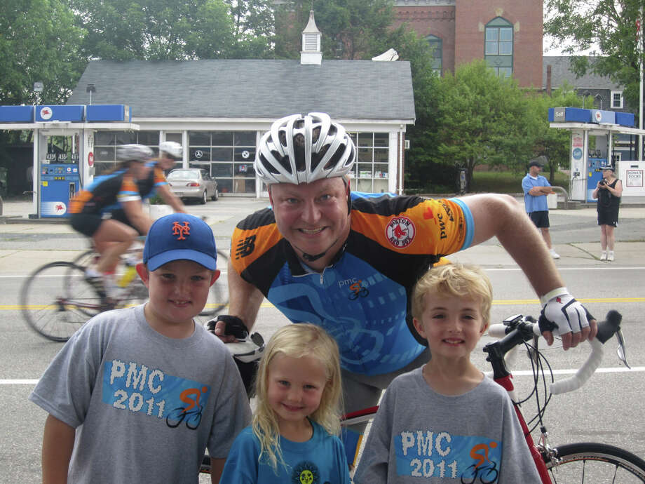 Terry Bock poses with three of his four children in Medfield, Mass., his wife Kerry's  hometown, 10 miles from the start on Day 1 of the PMC. The children, from left, are Tommy, 8, Kate, 4, and Kevin, 6. June 1, 2012, Darien, Conn. Photo: Contributed Photo