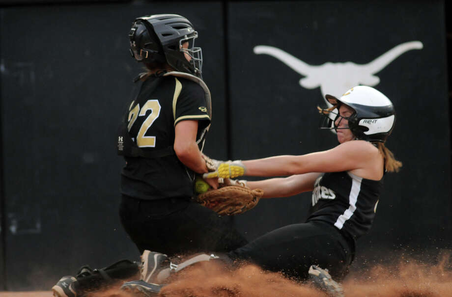 Danbury senior catcher Shelby Scott tags out Crawford baserunner Cameron Cale at home plate in the bottom of the 6th inning of their Class 2A semifinal matchup at the 2012 UIL State Softball Championships at McCombs Field in Austin on Wednesday. Photo: Jerry Baker, For The Chronicle