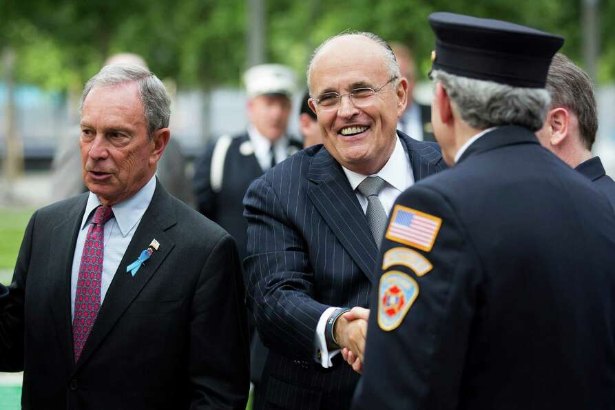 New York City Mayor Michael Bloomberg, left, and former New York City Mayor Rudy Giuliani welcome re