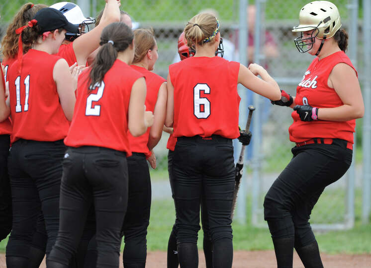 Guilderland's Jess Peck, right, crosses home plate after hitting a home run during a Class AA semifi