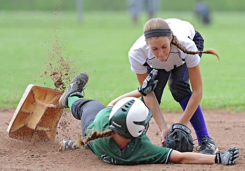 Catholic Central second baseman Eve Borden puts the tag on Shenendehowa's Melissa Morgan during a Cl