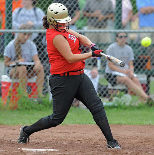 Guilderland's Jess Peck hits a home run during a Class AA semifinals softball game against Colonie a