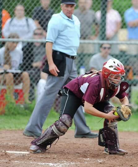 The umpire keeps a close eye on the foot of Colonie catcher Kassidy Ogren as she makes a forced out