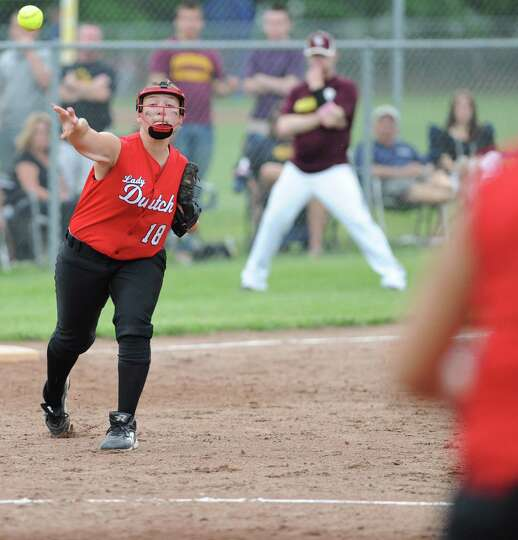 Guilderland third baseman Abi Peck throws the ball to first to get the runner out during a Class AA