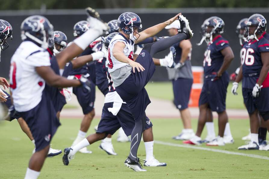 Texans wide receiver Kevin Walter, center, kicks high while warming up. (Brett Coomer / Houston Chro