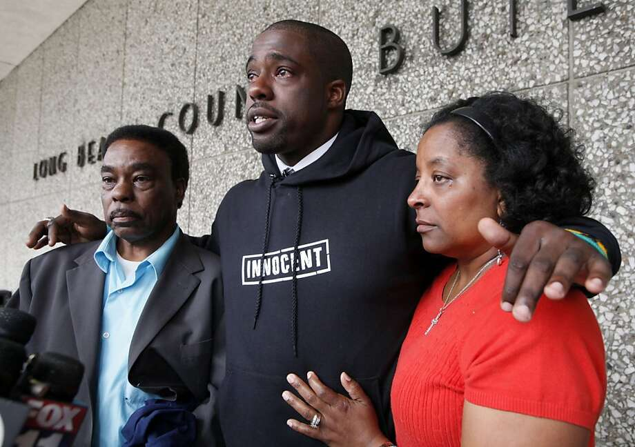 Brian Banks, center, reacts with his mother, Leomia Myers and father, Jonathan Banks, outside court after his rape conviction was dismissed Thursday May 24, 2012 in Long Beach, Calif. Banks, a former Long Beach high school football star and prized college recruit who served more than five years in prison for a rape he did not commit had his conviction overturned Thursday with his accuser recanting her story( AP Photo/Nick Ut) Photo: Nick Ut, Associated Press