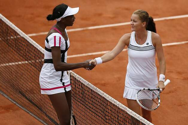Poland's Agnieszka Radwanska (R) shakes hands with US Venus Williams after she won their Women's Singles 2nd Round tennis match of the French Open tennis tournament at the Roland Garros stadium, on May 30, 2012 in Paris.    AFP PHOTO / KENZO TRIBOUILLARDKENZO TRIBOUILLARD/AFP/GettyImages Photo: Kenzo Tribouillard, AFP/Getty Images