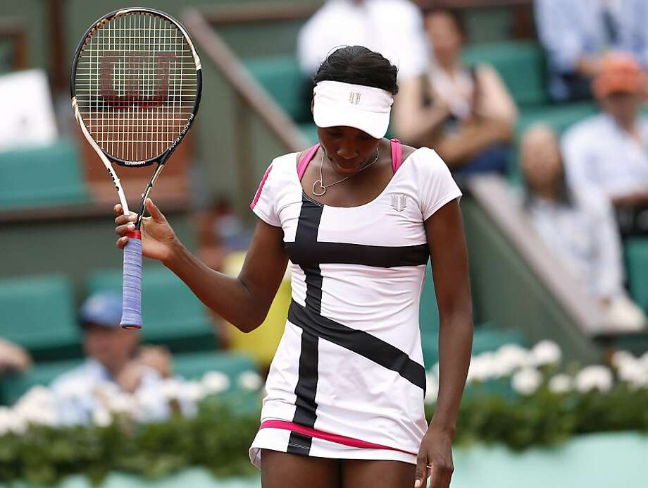 US Venus Williams reacts after a point against Poland's Agnieszka Radwanska during their Women's Singles 2nd Round tennis match of the French Open tennis tournament at the Roland Garros stadium, on May 30, 2012 in Paris.    AFP PHOTO / KENZO TRIBOUILLARDKENZO TRIBOUILLARD/AFP/GettyImages Photo: Kenzo Tribouillard, AFP/Getty Images