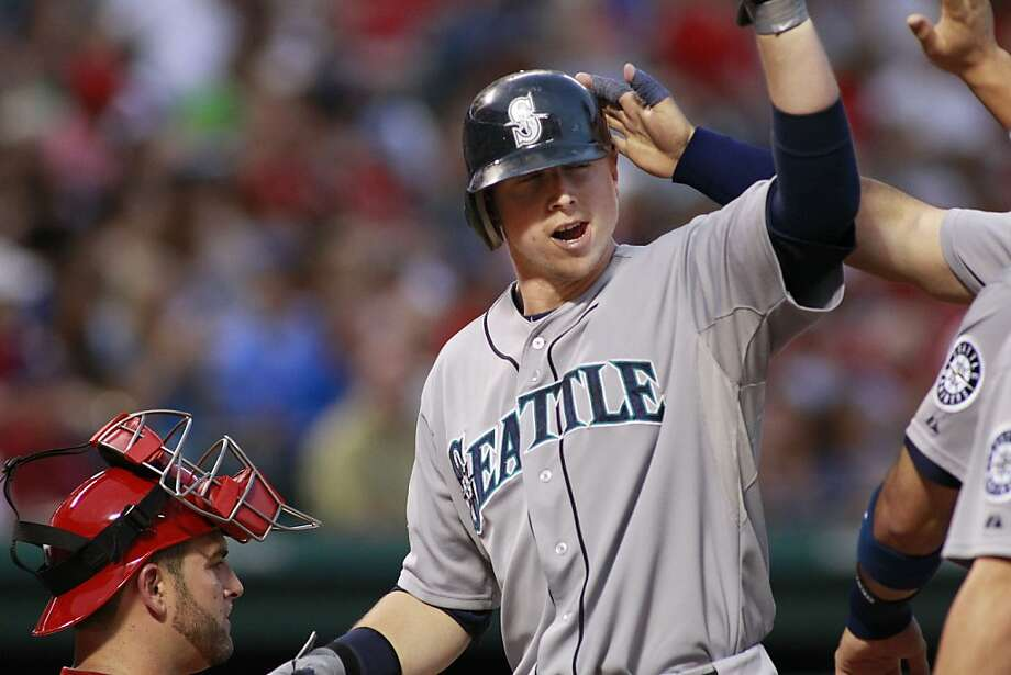 The Seattle Mariners' Justin Smoak is greeted at home plate after his three-run home run in the third inning against the Texas Rangers at The Ballpark in Arlington, on Wednesday, May 30, 2012, in Arlington, Texas. (Paul Moseley/Fort Worth Star-Telegram/MCT) Photo: Paul Moseley, McClatchy-Tribune News Service