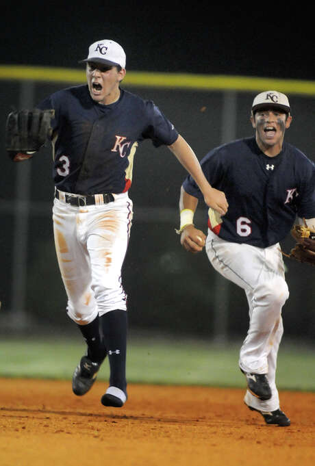 Klein Collins infielders Austin Dean, left, and CJ Hinejosa celebrate the last out of their 5-4 win over Klein. Photo by Jerry Baker. Photo: Jerry Baker / Freelance