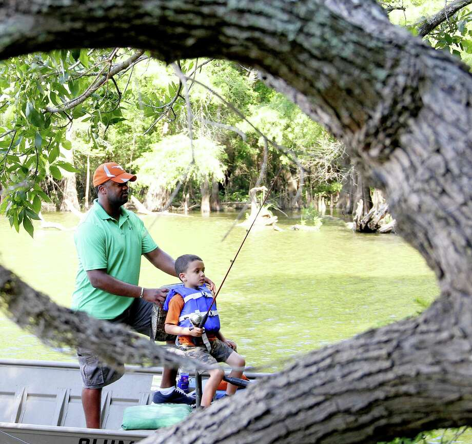 Larry Beharry helps his son Joseph, 4, on a recent fishing trip in southeast Texas. Almost all of the nation's 40-milllion-plus anglers were introduced to fishing through parents or other relatives who took the time to pass along skills, allowing youngsters to develop direct, lifelong connections with the natural world. Photo: Shannon Tompkins