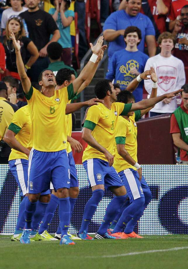 LANDOVER, MD - MAY 30: Romula #8 of Brazil celebrates with teammates after the Brazil team scored the first goal against USA during an International friendly game at FedExField on May 30, 2012 in Landover, Maryland. Photo: Rob Carr, Getty Images / 2012 Getty Images