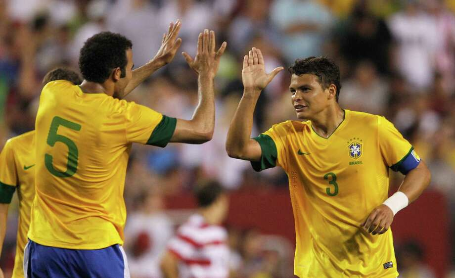 LANDOVER, MD - MAY 30: Thiago Silva #3 of Brazil celebrates scoring a goal with teammate Sandro #5 against USA during an International friendly game at FedExField on May 30, 2012 in Landover, Maryland. Photo: Rob Carr, Getty Images / 2012 Getty Images