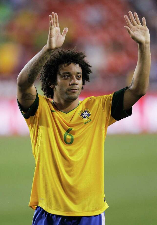 LANDOVER, MD - MAY 30: Marcelo #6 of Brazil waves to the crowd after beating USA 4-1 during an International friendly game at FedExField on May 30, 2012 in Landover, Maryland. Photo: Rob Carr, Getty Images / 2012 Getty Images