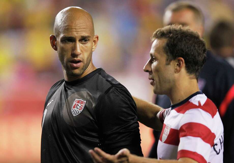 LANDOVER, MD - MAY 30: Goalie Tim Howard #1 (L) walks off the field with Steve Cherundolo #6 of USA after losing 4-1 to Brazil during an International friendly game at FedExField on May 30, 2012 in Landover, Maryland. Photo: Rob Carr, Getty Images / 2012 Getty Images