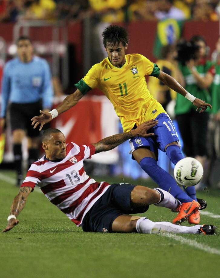LANDOVER, MD - MAY 30:  Neymar #11 of Brazil and Jermaine Jones #13 of USA collide going after the ball during an International friendly game at FedExField on May 30, 2012 in Landover, Maryland. Photo: Rob Carr, Getty Images / 2012 Getty Images