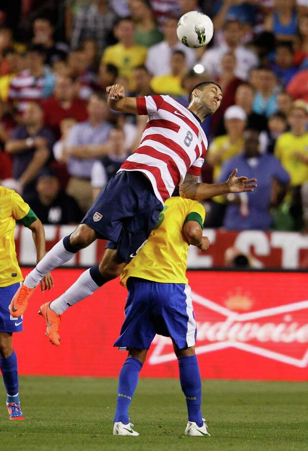 LANDOVER, MD - MAY 30:  Clint Dempsey #8 of USA heads the ball against Brazil during an International friendly game at FedExField on May 30, 2012 in Landover, Maryland. Photo: Rob Carr, Getty Images / 2012 Getty Images