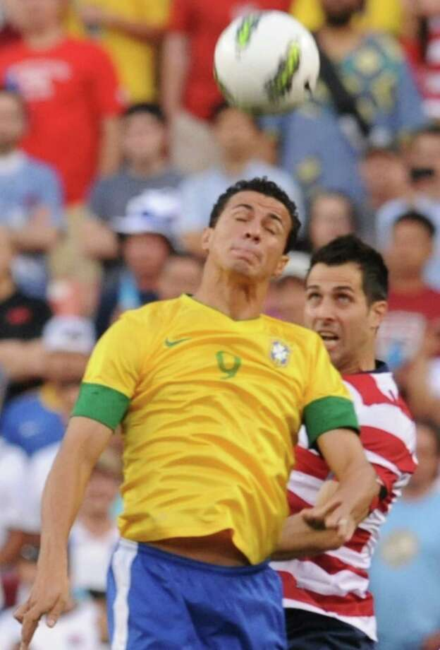 Brazil's Leandro Damiao (L) and Carlos Boanegra (R) of the US go for the header during an international friendly at FedEx Field in Landover, Maryland, on May 30, 2012.   AFP PHOTO/Nicholas KAMMNICHOLAS KAMM/AFP/GettyImages Photo: NICHOLAS KAMM, AFP/Getty Images / AFP