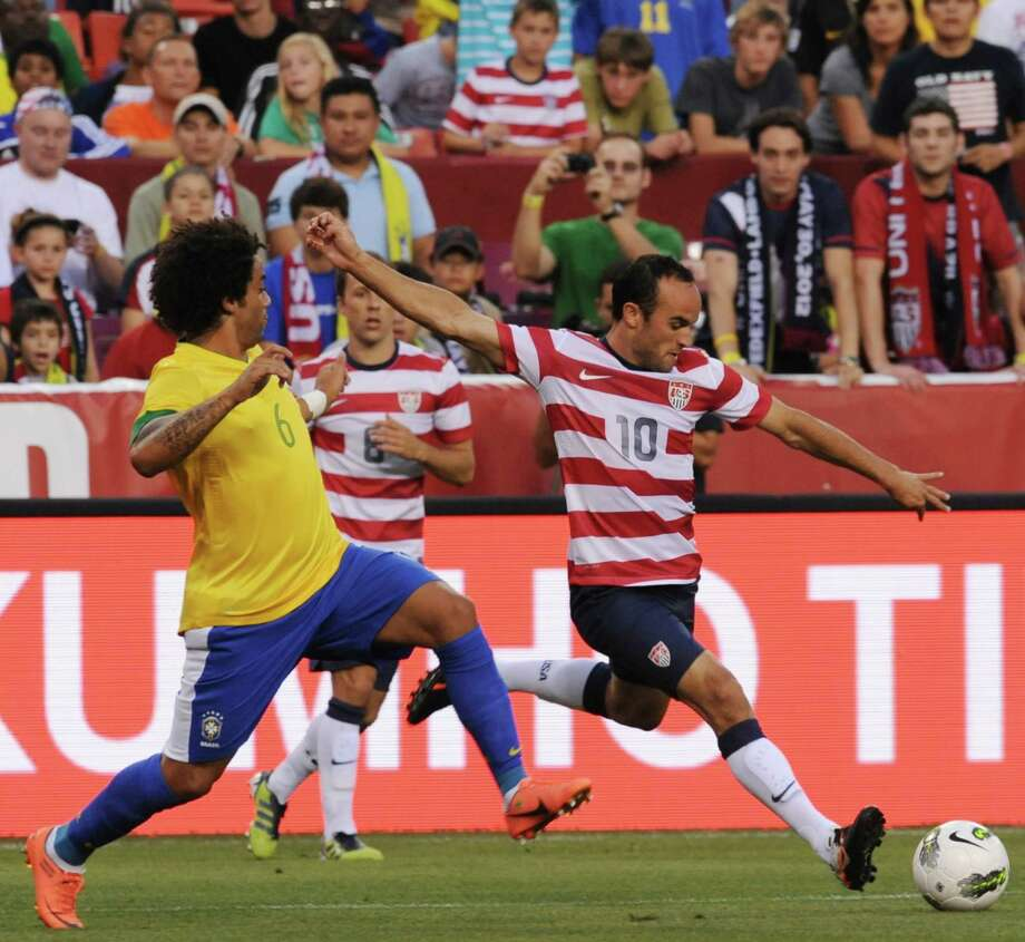 Landon Donovan (R) of the US moves the ball past Marcelo (L) of Brazil during an international friendly at FedEx Field in Landover, Maryland, on May 30, 2012.   AFP PHOTO/Nicholas KAMMNICHOLAS KAMM/AFP/GettyImages Photo: NICHOLAS KAMM, AFP/Getty Images / AFP