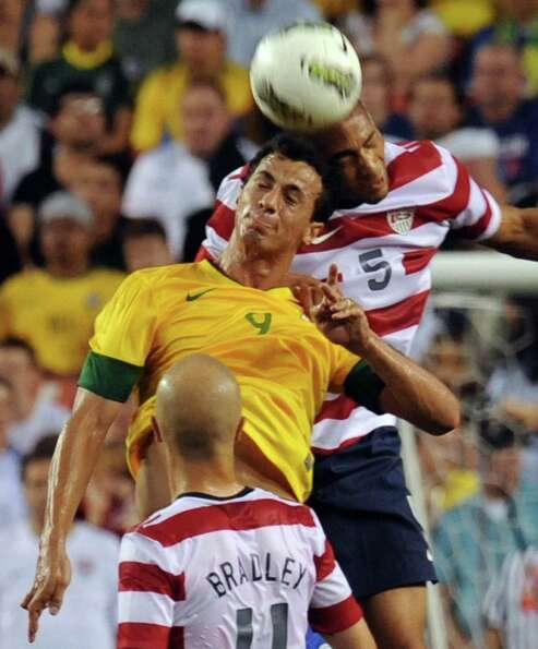 Oguchi Onyewu (R) of the US and Brazil's Leandro Damaio (L) go for the header during an internationa