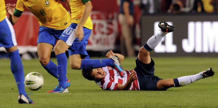 Terrence Boyd (R)  of the US takes a fall against Brazil during an international friendly at FedEx Field in Landover, Maryland, on May 30, 2012.   AFP PHOTO/Nicholas KAMMNICHOLAS KAMM/AFP/GettyImages Photo: NICHOLAS KAMM, AFP/Getty Images / AFP