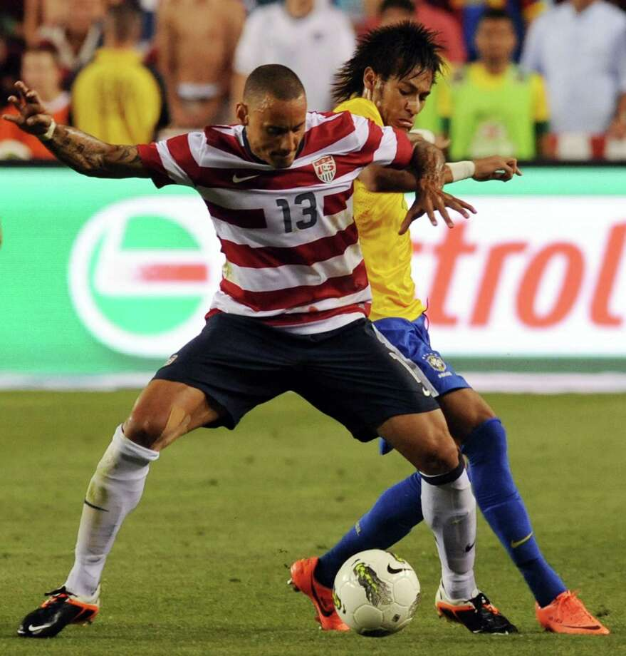 Jermaine Jones (L) of the US and  Nemar (R) of Brazil vie for the ball during an international friendly at FedEx Field in Landover, Maryland, on May 30, 2012.  Brazil won 4-1.  AFP PHOTO/Nicholas KAMMNICHOLAS KAMM/AFP/GettyImages Photo: NICHOLAS KAMM, AFP/Getty Images / AFP
