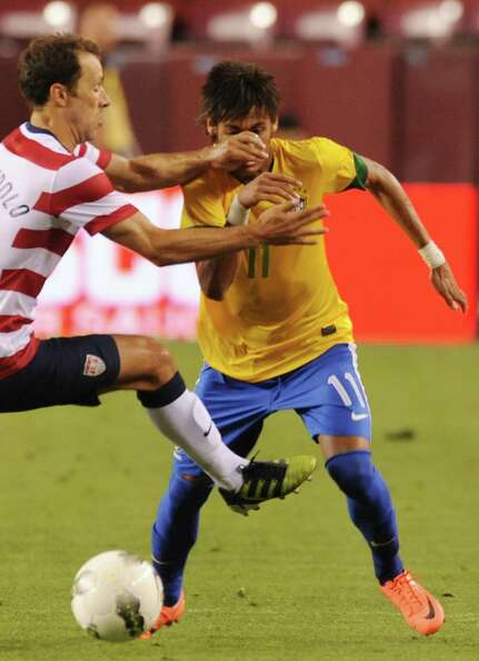 Steve Cherundolo (L) of the US and  Nemar (R) of Brazil vie for the ball during an international fri