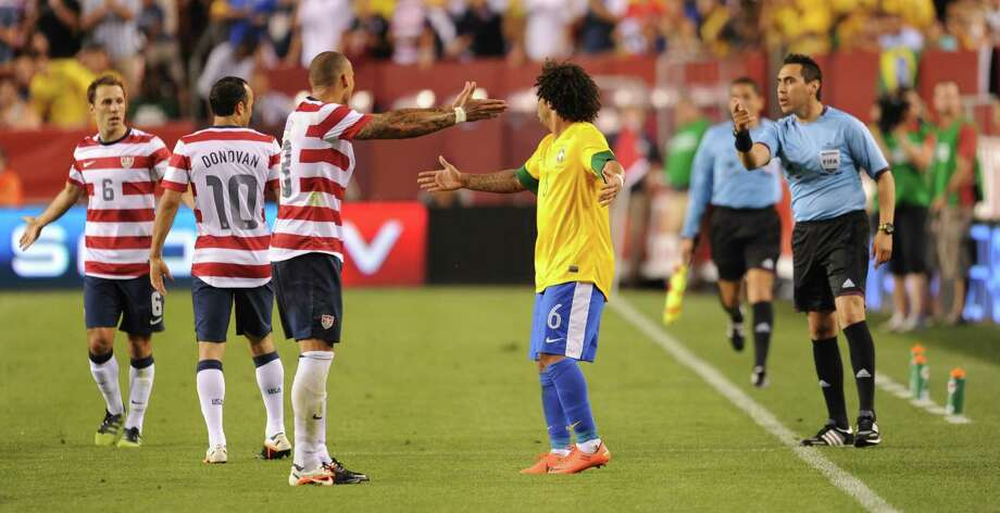 Jermaine Jones (3rd-L) of the US and Marcelo (3rd-R) of Brazil dispute a play during an international friendly at FedEx Field in Landover, Maryland, on May 30, 2012.  Brazil won 4-1.  AFP PHOTO/Nicholas KAMMNICHOLAS KAMM/AFP/GettyImages Photo: NICHOLAS KAMM, AFP/Getty Images / AFP