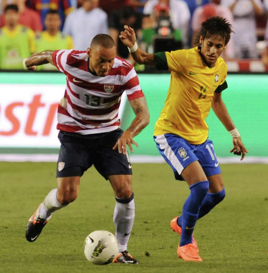 Steve Cherundolo (L) of the US and  Nemar (R) of Brazil vie for the ball during an international friendly at FedEx Field in Landover, Maryland, on May 30, 2012.  Brazil won 4-1.  AFP PHOTO/Nicholas KAMMNICHOLAS KAMM/AFP/GettyImages Photo: NICHOLAS KAMM, AFP/Getty Images / AFP