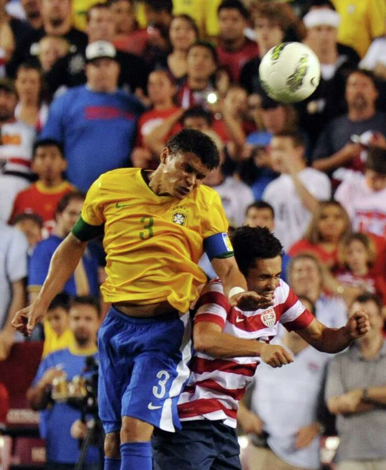 Thiago Silva (L) of Brazil and Carlos Bocanegra (R) of the US go for the header during an international friendly at FedEx Field in Landover, Maryland, on May 30, 2012.  Brazil won 4-1.  AFP PHOTO/Nicholas KAMMNICHOLAS KAMM/AFP/GettyImages Photo: NICHOLAS KAMM, AFP/Getty Images / AFP