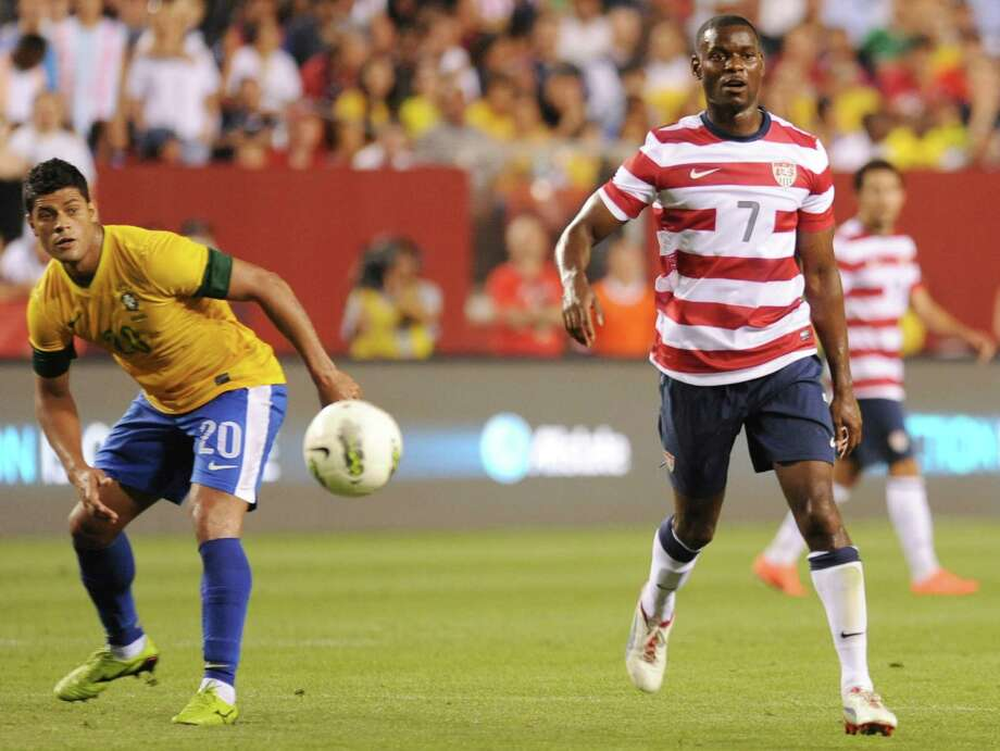 Hulk (L) of Brazil and Maurice Edu (R) of the US look down field during an international friendly at FedEx Field in Landover, Maryland, on May 30, 2012.  Brazil won 4-1.  AFP PHOTO/Nicholas KAMMNICHOLAS KAMM/AFP/GettyImages Photo: NICHOLAS KAMM, AFP/Getty Images / AFP