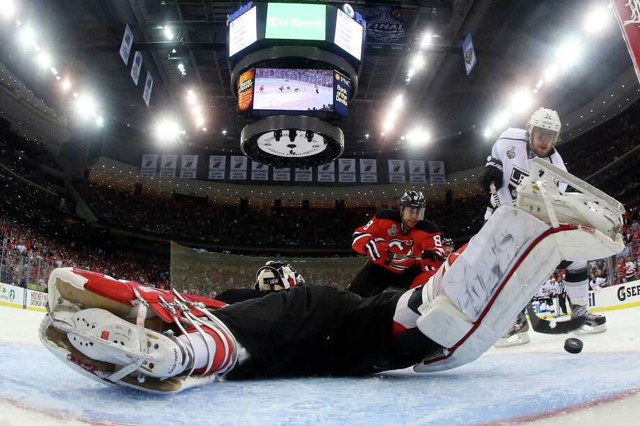 After a fake put Devils goalie Martin Brodeur out of position, the Kings' Anze Kopitar has no trouble putting the puck into the net for the winning goal. Photo: Bruce Bennett / 2012 Getty Images