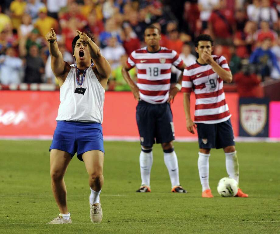 A fan runs onto the field  during an international friendly between the US and Brazil at FedEx Field in Landover, Maryland, on May 30, 2012.  Brazil won 4-1. Police arrested the fan.   AFP PHOTO/Nicholas KAMMNICHOLAS KAMM/AFP/GettyImages Photo: NICHOLAS KAMM, AFP/Getty Images / AFP
